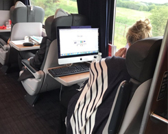 Passenger Shows The Surprising Portability of iMacs By Using One On A Train